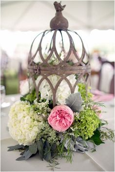 Love this centerpiece! ! The peonies are beautiful but I would love cacti and succulents instead! I also love that the bird cage is rusty. Rustic wedding