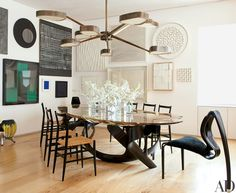 Sun Valley _ Italian architect Achille Salvagni's Octopus chandelier stretches above the sculptural dining table by Joseph Walsh Studio, which also produced the pair of Enignum II chairs. Vintage Superleggera chairs by Gio Ponti for Cassina.