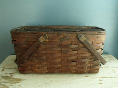 Antique picnic basket made of natural woven oak wood slats with hardwood trim and swing bentwood handles