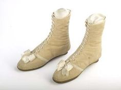 Ankle Boot    These woman's lace-up ankle boots are made from nankeen, a yellowish type of cotton fabric originally made in China, trimmed with a bow and bindings of silk ribbon. (1815)