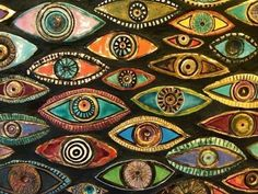 """946. Eye, eye, eye... I had never seen so many eyes. """"What are they... Why do you have them?"""" """"You'd be amazed what they can catch."""" A small blue eye, sandwiched between a large spiraling red eye and a chunky orange eye, rolled over and glanced at me before blinking just once. #946."""