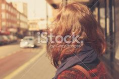 Young woman at bus stop Royalty Free Stock Photo
