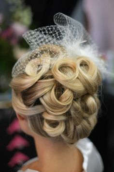 Vintage wedding up-do with a birdcage veil. Perfectly formed soft curls are just the right touch for such an elegant wedding. Hair by Pink The Beauty Boutique 864-592-2554