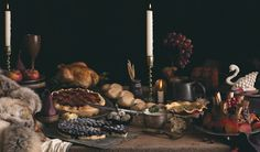 (1) Table styling ideas for a medieval feast, utilising wood, metals, candlelight and a lot of simple rustic food.