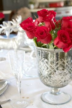 Silver and white with bunches of bright red roses to make a table setting perfect for New Year's, Valentine's or any special celebration.