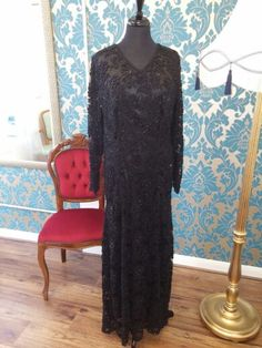 Beaded lace floor length evening gown.
