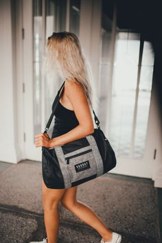 The Roadie Gym Duffel, perfect for fitness on the go - shown in Black Heather Gray. Purchase your favorite gym bag today at Vooray, starting at $29.99.                                                                                                                                                                                 More