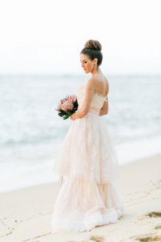 Two layered strapless blush wedding dress: http://www.stylemepretty.com/2016/10/01/blush-pink-wedding-dresses/ Photography: Carmen and Ingo - http://carmenandingo.com/