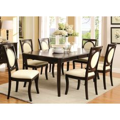 Bring a classic and modern design into your home with this montblanc O designed dining set, constructed from solid wood in a clean but stylish design, Chairs feature a O design woven fabric upholstered back for supreme comfort and style