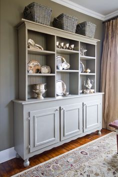 love the open shelving over this buffet...and the beadboard
