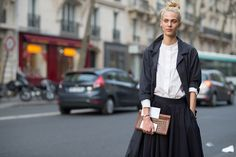The Best Street Style From Paris Fashion Week  - ELLE.com. high neck white button down blouse. Charcoal jacket and charcoal skirt. #minimal #minimalist #minimalism