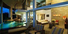 Manuel Antonio villa rental - Open design of living room, indoor infinity pool, and kitchen