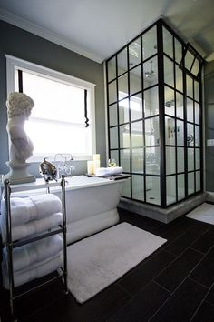 Stunning glass shower. Great black, gray and white bath described in article.