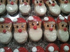 nutter butter Santas. Made with the kids on Saturday. We omitted the red hot nose and dipped the entire cookie in almond bark.