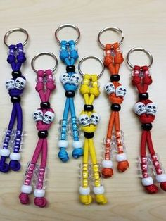 Keychain is made of durable 550 paracord, pony beads, and skull beads. The length measures approximately inches long. Paracord Tutorial, Paracord Keychain, Paracord Bracelets, 550 Paracord, Bead Keychain, Pony Bead Patterns, Beading Patterns, Homemade Crafts, Crafts To Make