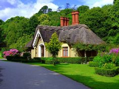 Adare, Ireland. How beautiful it this?  Adare, County Limerick, Ireland: Right out of a storybook, this celebrated village of low-slung Tudor cottages is adorned with ivied churches and a moated castle from the days when knighthood was in flower.