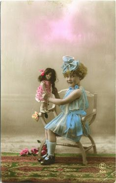 Little girl and doll