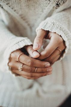 Love the sweater and delicate rings.. so my style