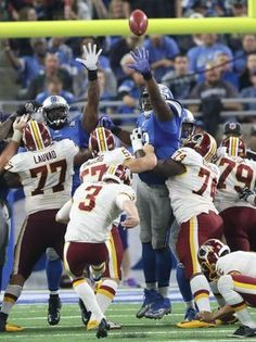 Redskins vs. Lions;   -   October 23, 2016  -  20-17, Lions  -     Detroit Lions defenders try to block a field goal by the Washington Redskins' Dustin Hopkins during the second half Sunday, Oct. 23, 2016 at Ford Field in Detroit.  Kirthmon F. Dozier, DFP