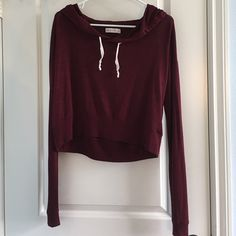 Abercrombie & Fitch Crop Hoodie Non-negotiable price!! Adorable burgundy hoodie from Abercrombie & Fitch. Extremely comfortable & casual. Very similar to the Brandy Melville design. Has long sleeves & hood. Abercrombie & Fitch Tops Sweatshirts & Hoodies