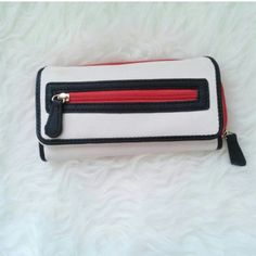 White and red wallet *12 card slots *3 Hidden Pockets *1 Small Front pocket *1 back zipper pocket with two dividers  Size: Length:4 1/2 inches  Width 8 inches Material Girl Bags Wallets