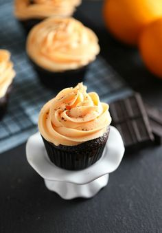 Moist and flavourful Chocolate Cupcakes topped with bright Orange Buttercream Frosting.