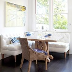 This L-shaped banquette bench is chic and practical. More breakfast room banquettes: http://www.bhg.com/kitchen/eat-in-kitchen/banquette-ideas/?socsrc=bhgpin122813whitebench&page=8