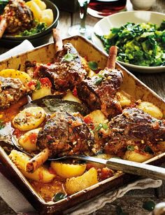 Greek lamb kleftiko with potatoes, oregano and lemon