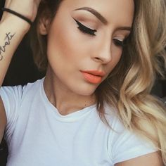 Bright lips and winged liner.
