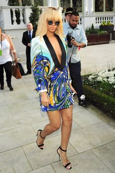 """Rihanna wears a low cut, multicolored blazer and high heels whilst leaving the Mandarin Oriental hotel in London. Rihanna is currently out promoting her first feature film """"Battleship""""."""