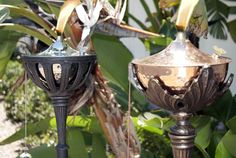 Maui Pedestal Torches - $99.99  Limited Stock! Stunning and substantial, the Maui  Pedestal Torch is truly a thing of beauty. Its heavyweight construction and ornate design add opulence to your outdoor deck, patio or poolside. The torch cradle has been designed to fit our Maui Tabletop Torches, giving you the flexibility to change torch finishes to match your decor or the holiday season.