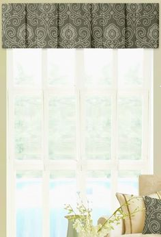 Small updates can make a big impact. A valance is a great way to add interest to a window, without blocking the view. Shown: Box Pleat with @RADesign Metro Magic Smoke Fabric, 100% Linen