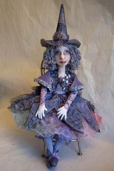 Sold the original winter witch.  This is her replacement.  Her colors are softer but I like the original face better ;-)