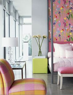 floral fabric wall as accent + plaids and brights