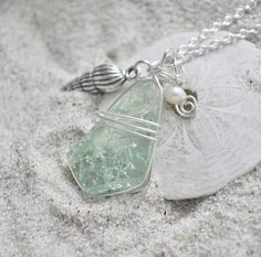 So love this necklace...  Seaglass Necklace with Conch Shell Charm and Pearls. $15.00, via Etsy.