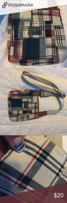 Tommy Hilfiger cross body purse Small cross body bag. 💼 the strap is similar to seatbelt material. Front pocket. Blue satin inside with a makeup pocket and 2 pouches for your cell phone. Last pic show tiny snag where, maybe, the tag was. Tommy Hilfiger Bags Crossbody Bags