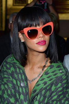 8f896ccf34 Rihanna in oversized coral  sunglasses during the Stella McCartney show Rihanna  Sunglasses