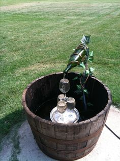 Wine bottle fountain pretty simple for about 125 went for Wine bottle fountain