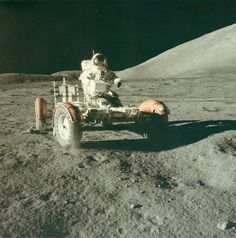 Picture of astronaut Eugene Cernan testing the lunar rover on the moon in 1972