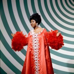 Aretha Franklin's voice is larger than life, but her style is even more grand. Tunics, turbans, and feathers galore set her apart from your typically prim and proper 1960's style. This moment, on The Andy Williams show in 1965 was most memorable.