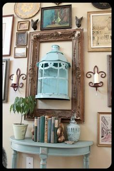 I love this idea for a display of flowers or objets d'art: a half birdcage mounted on the wall, surrounded by a vintage frame. Sort of a combination eclectic, bohemian, shabby cottage chic vibe. -I have a half bird cage and an empty frame. Room Decor, Decor, Decor Inspiration, Home Diy, Eclectic Gallery Wall, Shabby Chic, Shabby, Picture Frames, Home Decor