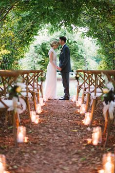 Candlight Ceremony at Dusk - http://www.StyleMePretty.com/midwest-weddings/2014/03/24/elegant-dusk-wedding-ideas/ Photography: m three studio - mthreestudio.com #SMP