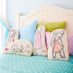Pillows in the shape of Snow White, Tinker Bell, Rapunzel, and Pocahontas. | 30 Magical Disney Decorations You Need In Your Life