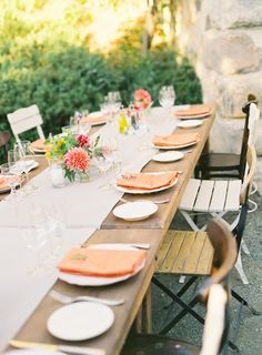 Happy Wedding Wednesday! We love the simple set up for this beautiful table setting - great for an outdoor reception or bridal shower. The POP of cheery color from the napkins and floral centerpieces really make this table unique. #weddings #decor #tabletop