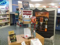 "A great ""Zombies Take the Library"" book display at the Schusterman-Benson Library in Tulsa, OK. There was a contest where teens wrote down their best zombie survival tactics. Neat idea! Thanks for sharing Michelle!"