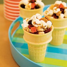 Snack Cones  Ingredients:  3 cups popcorn  2 cups multigrain cereal  1 cup dried fruit bits  24 wafer ice-cream cones  X     Instructions  1.Just combine the popcorn, cereal, and dried fruit bits. Scoop the mix into wafer ice-cream cones (you should have enough to fill about two dozen). To keep them from spilling in transit, cover each cone with plastic wrap held in place with a rubber band.