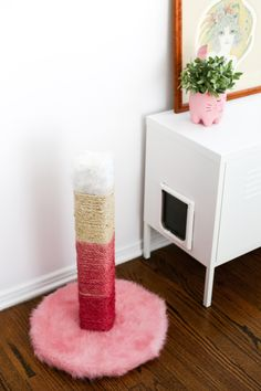 Hate your brown, ugly, carpeted cat scratching post? DIY one! And make it ombre pink! // saltycanary.com #ad