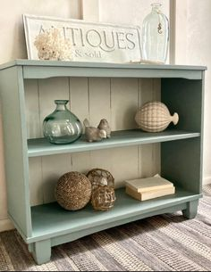 I found this solid wood bookcase in our local thrift store. It is in perfect condition and has the cutest little legs. It has somewhat of an Asian flair to it. I knew I wanted to do something different on the back so I took a small rubber mallet and punched out the back. It was so easy to do. After that I hammered out the rest of the staples. I used an echo friendly white paint for the back. It took several coats, but was definitely worth it. I wanted a coastal feel so I painte Upscale Furniture, Upcycled Furniture, Painted Furniture, Painting Bookcase, Bookcase Makeover, Picture Shelves, Patio Cushions, Ikea Chair