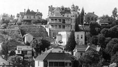 "(Los Angeles, CA,1898) - The Crocker Mansion and neighbors on Bunker Hill. Construction on the Third Street tunnel began in 1900. Mrs. Crocker filed a petition claiming that the mansion was endangered by the street tunnel which was ""unsafe, improperly constructed and a veritable death trap."" The house was alive and well in 1902 when Angels Flight began operating and dropping riders off practically on the Crocker doorstep."