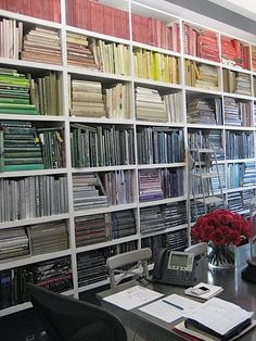 More books arranged by color.  That, coupled with the artful arrangement on each shelf, makes me weep with organizational joy.
